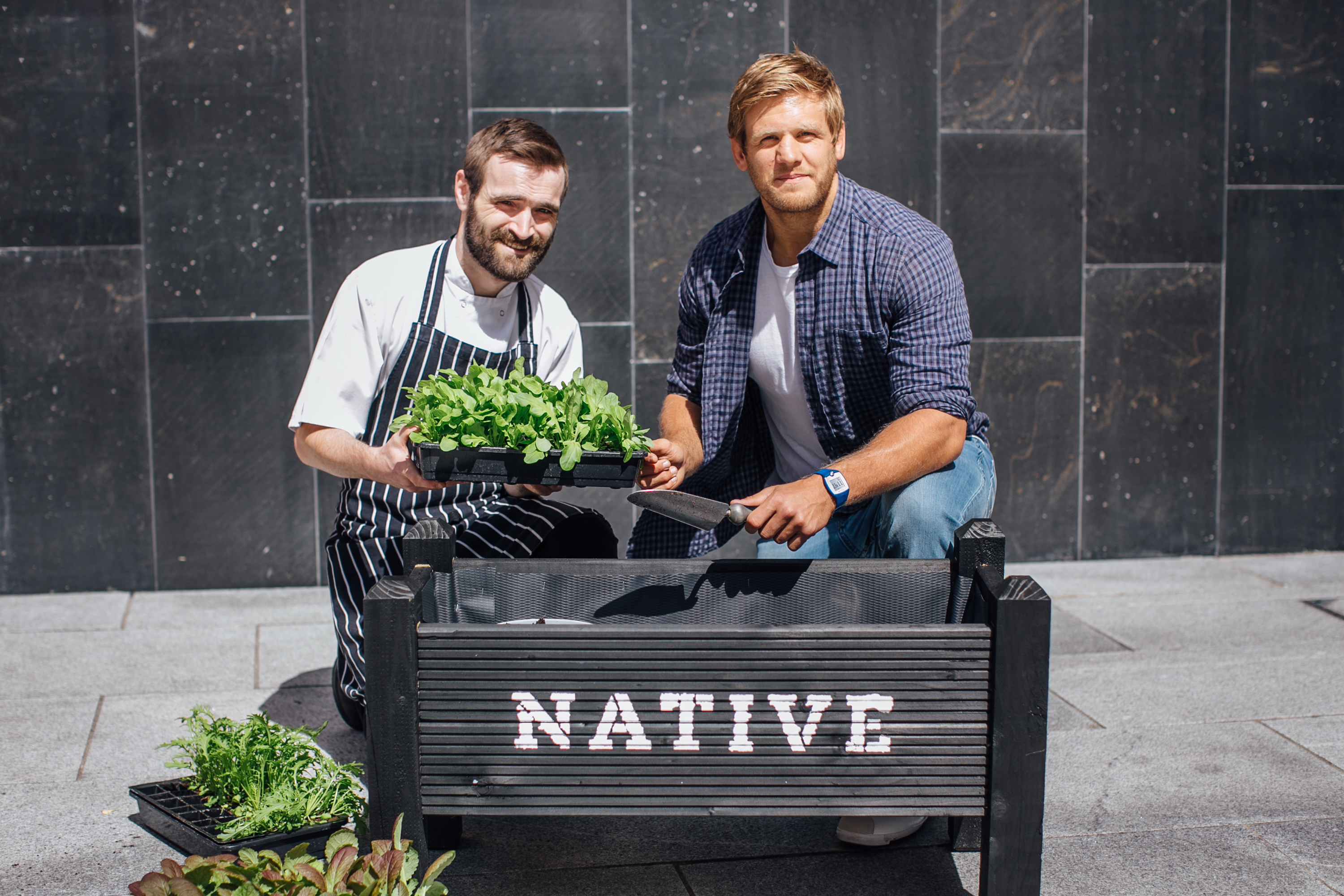 Rugby international star, Chris Henry gives Native chef, Barry Heaton a helping hand planting herbs for the restaurant kitchen. Located in the MAC arts venue at St Anne's Square in Belfast's busy Cathedral Quarter, Native is the latest outlet for Yellow Door Group, which is also the exclusive corporate caterer for Ulster Rugby at the Kingspan Stadium, Belfast. Picture by Geoff Telford Photography.